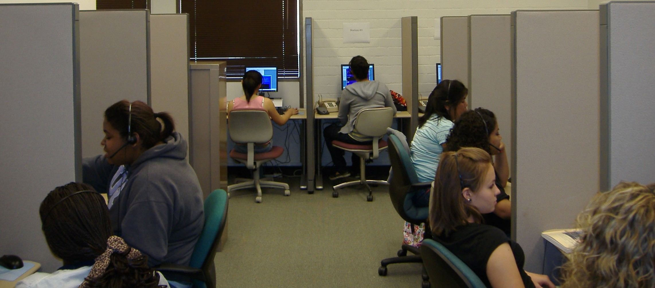 Interviewers work on a telephone survey in the 16-station CATI laboratory at the UCR SRC.